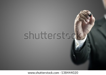 Business man writing with marker - stock photo