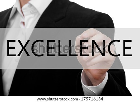 business man writing word Excellence on glass board - stock photo
