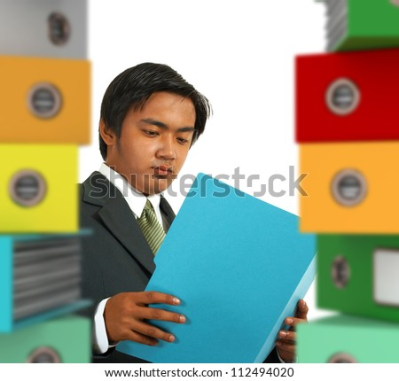 Business Manager Being Overworked With Office Paperwork - stock photo