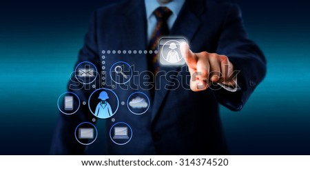 Business manager is pressing a virtual push button to access the support of a female knowledge worker. Technology metaphor for plug-and-play workers, minijobbers, contractors and freelancing. - stock photo