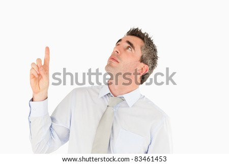 Business manager pointing at a copy space against a white background