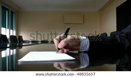 Business Manager writing on blank paper, business concept - stock photo