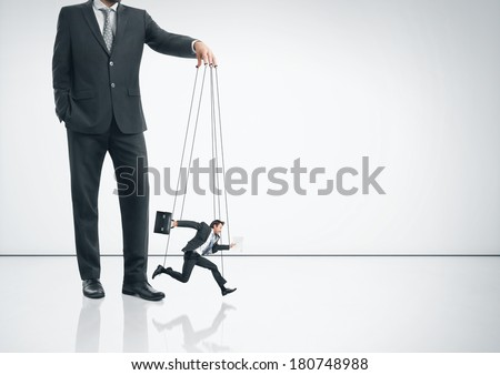 Business marionette running fast - stock photo