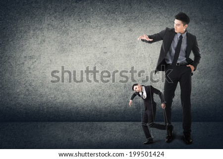 Business marionettes concept by Asian young executive. - stock photo