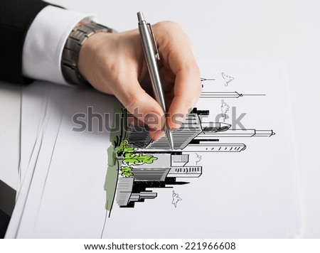 business, marketing, planning and people concept - close up of male hand with pen drawing city on white paper - stock photo