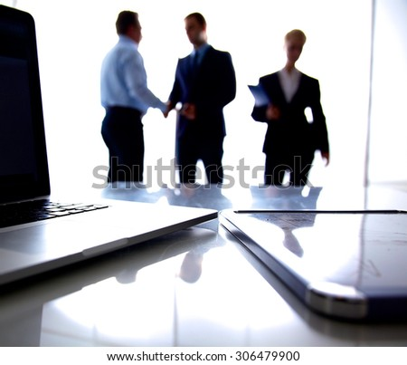Business meeting at the table shaking hands conclusion of the contract - stock photo