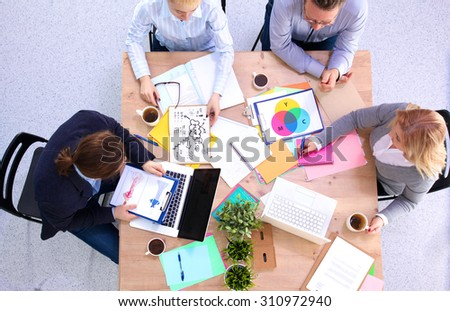 business meeting at the table top view - stock photo