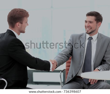 Business meeting at the table with handshake