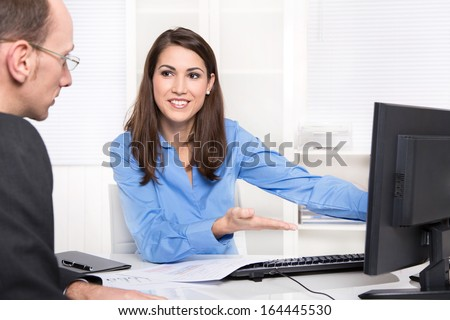 Business meeting - customer and adviser at desk. - stock photo