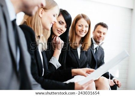 Business meeting. Group of professionals reading cv. Job interview