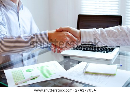 business meeting, handshake close up in office background - stock photo