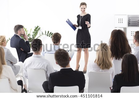 Business meeting in a successful company. Boss choosing employee of the month - stock photo
