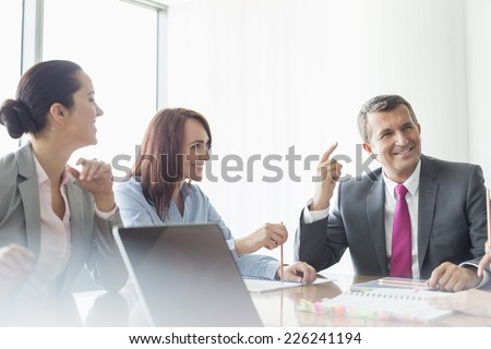 Business meeting in boardroom - stock photo