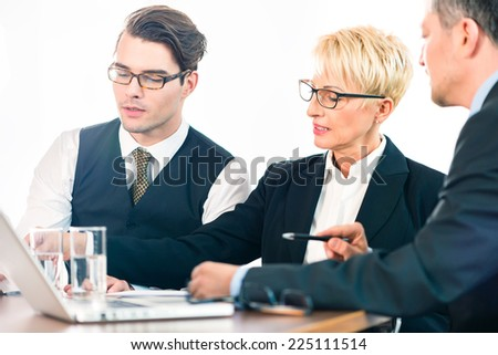 Business - meeting in office, the businesspeople are discussing a document on Laptop computer and working as team - stock photo