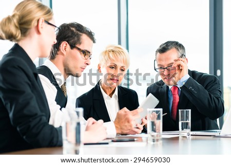 Business - meeting in office, the businesspeople or lawyers in team are discussing a document on Laptop computer - stock photo
