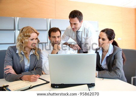 Business meeting in office with laptop computer - stock photo