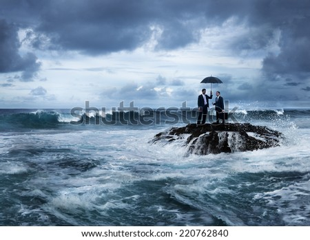 Business meeting in stormy ocean - stock photo