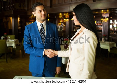 business meeting man and woman in a restaurant