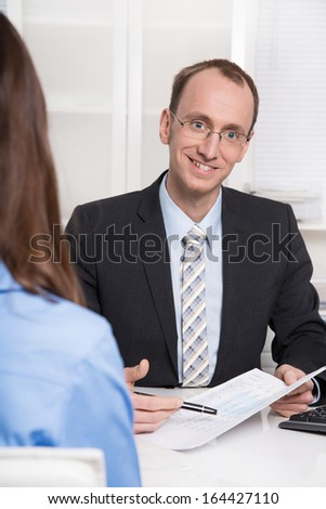 Business meeting - man and woman talking together. - stock photo
