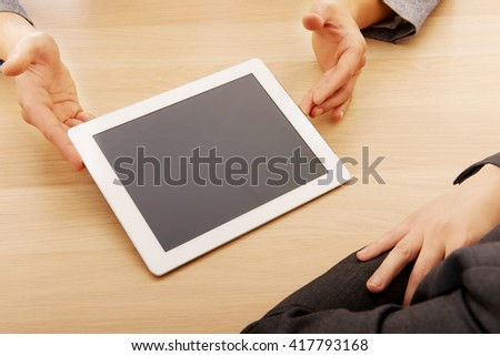 Business meeting-man showing something on tablet - stock photo