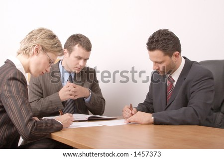 Business meeting - 2 men, 1 woman, - signing contract - stock photo