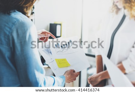 Business meeting, photo documents holding hands. Photo account managers crew working with new startup project.Idea presentation, analyze marketing plans. Blurred, film effect. Horizontal