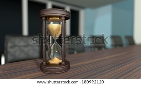 business meeting room interior with sand clocks on the tabletop - stock photo