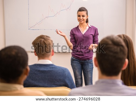 Business meeting. Teamwork concept. Young business woman with speech to colleagues. - stock photo
