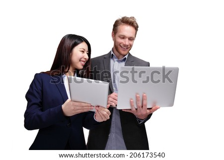 Business meeting - two managers discussing on digital tablet and laptop computer isolated on white background, caucasian and asian