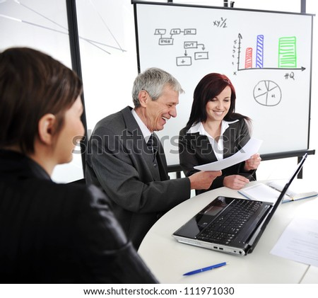 Business meeting with board presentation diagrams - stock photo
