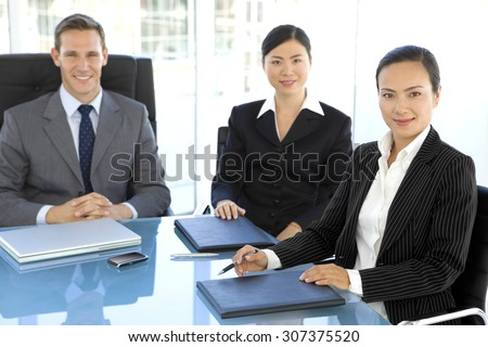 Business meeting with Chinese - stock photo
