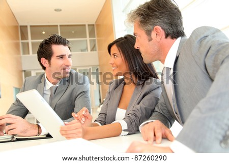 Business meeting with electronic tablet