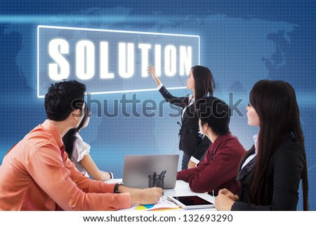 Business meeting with presentation a solution on blue world map background - stock photo