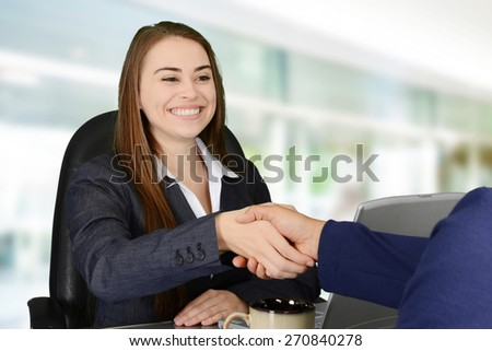Business meeting with two women happening in an office - stock photo