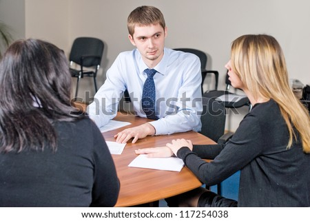 Business meeting - Young man presenting his ideas to colleagues - stock photo