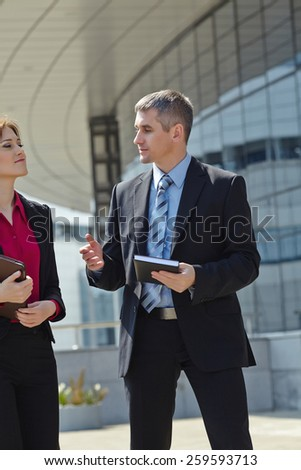 business men and woman outdoor