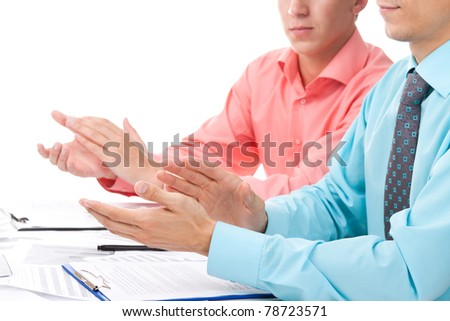 business men applauding with colleagues during presentation sitting at the desk, isolated over white background. Concept Success, Approval, Good Work, - stock photo
