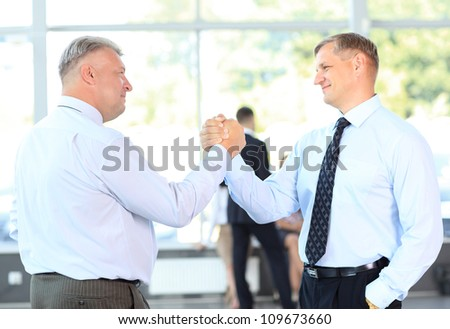 Business men closing deal with a handshake - stock photo