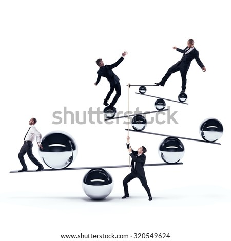 Business men cooperate to maintain the balance - stock photo