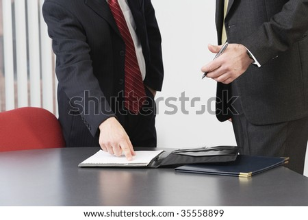 Business men discussing in an office. - stock photo