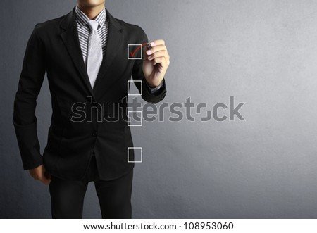 Business men hand drawing in a whiteboard - stock photo