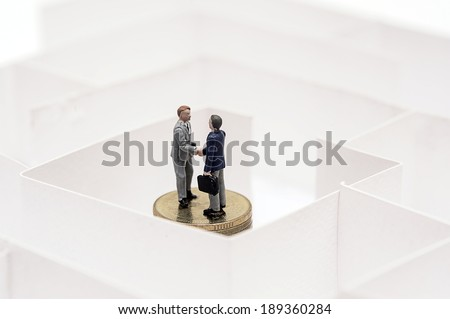 Business men in a maze - stock photo