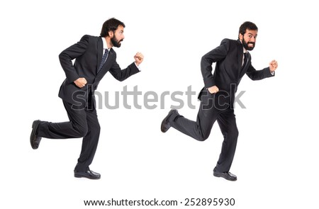 Business men running fast over white background - stock photo