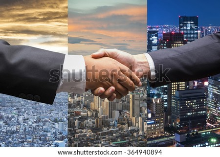 Business men shaking hands in businness background - stock photo