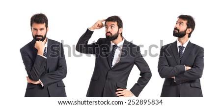 Business men thinking over isolated white background - stock photo