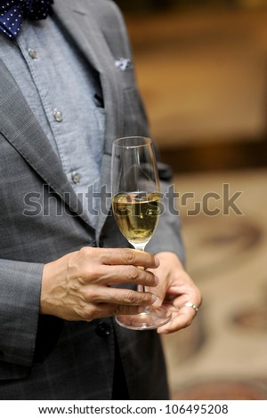 business men with glass of champagne - stock photo