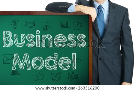 Business Model on blackboard presenting by businessman or teacher - stock photo