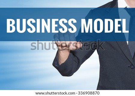 Business Model word Business man touching on blue virtual screen - stock photo