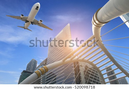 Business modern tower with airplane flying over building at Train station BTS Chong nonsi in Bangkok Thailand