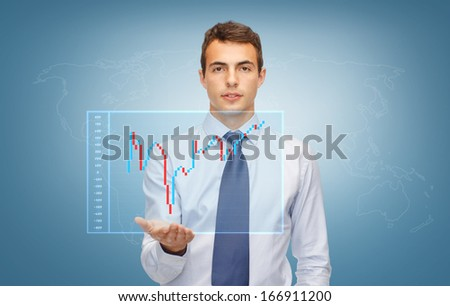 business, money and office concept - friendly young buisnessman showing forex chart on the palm of his hand - stock photo